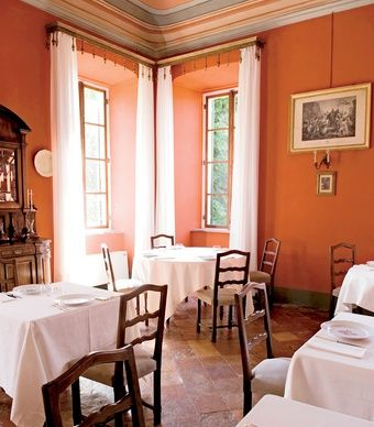 The dining room in Castello di Verduno, in Italy's Piedmont Region, where guests can sample Barolo from the castle's cellars. (Andrea Wyner)