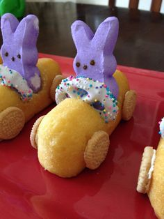 easter bunny race cars- wonderfuldiy 5Ingredients: Large Marshmallows, cut horizontally Marshmallow Bunny Peeps Mini pretzels Cream-Filled Cakes (e.g. Cloud Cakes or Twinkies) Decorator Icing Frosting Sprinkles