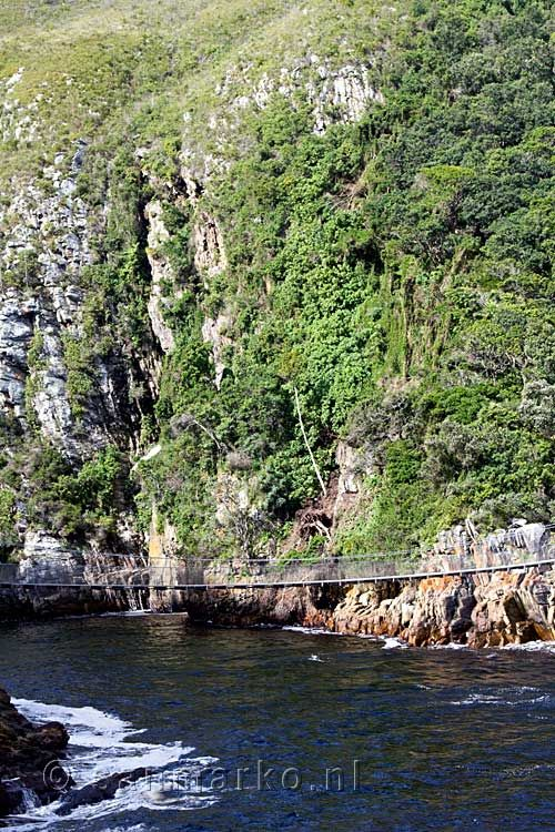 The river mouth and the worn rocks at the Suspension Bridge in Tsitsikamma National Park in South Africa