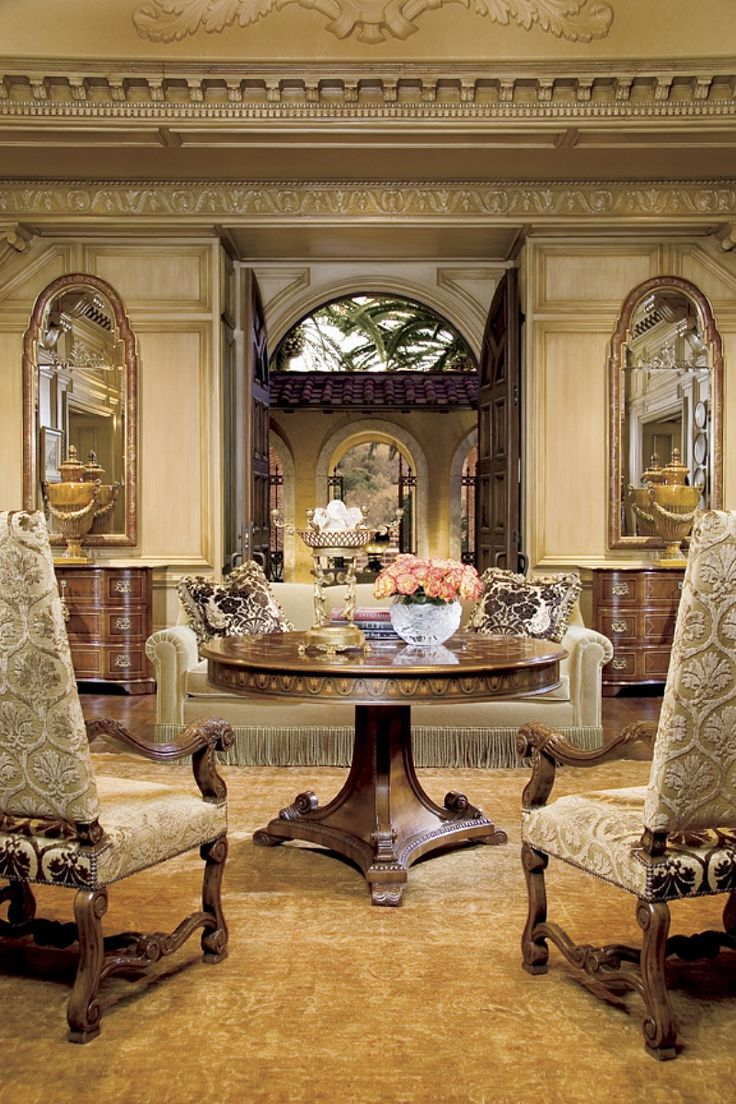 ebanista - Pair of mirrors and chests flanking doorway - circular center table, stately pair of handsome armchairs, color design, style, inspiration.