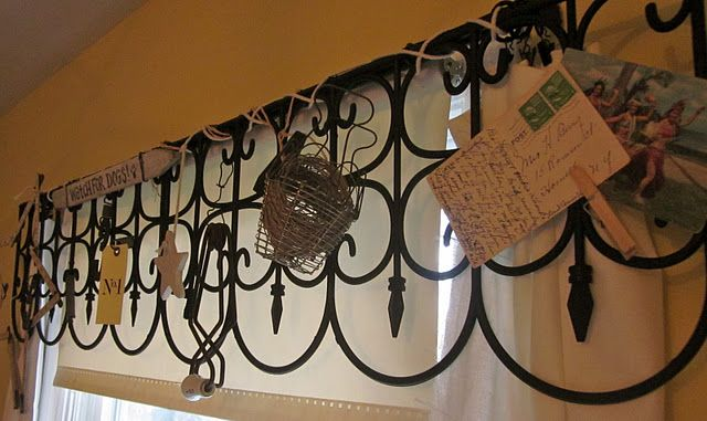 A garden gate window treatment - black plastic garden borders would be lightweight enough to hang pretty easily. I'm thinking this would look great in a craft room!
