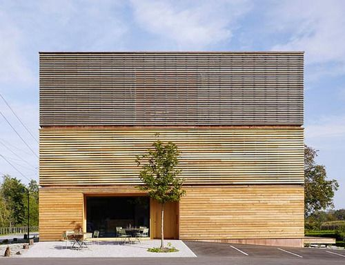 Saunahaus by Bernardo Bader Architects Timber slat façades function as louvres, and the gaps between the slats only increase on the upper floors to ensure privacy.