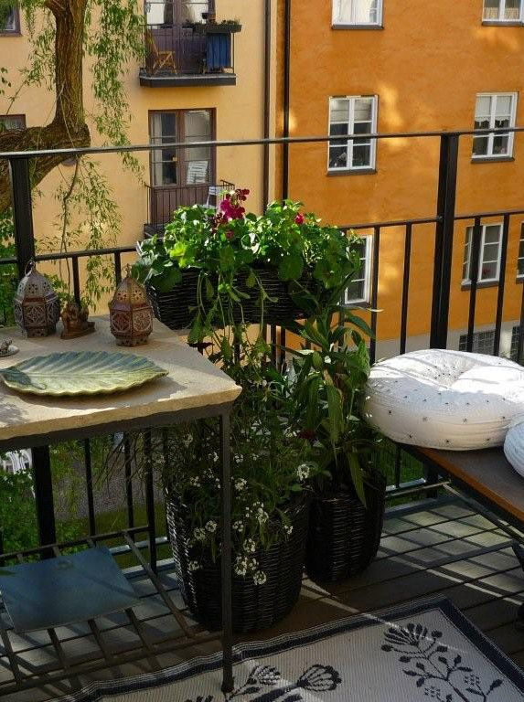 Lawn & Garden White Carpet On Beautiful Balcony Design Ideas Square Wooden Table Black And Round White Pillows Black Iron Fence Green Plant Wooden Bench Wooden Floor House Balcony Smart Ways Decoration of Small Balcony Design Ideas Look Wondrous