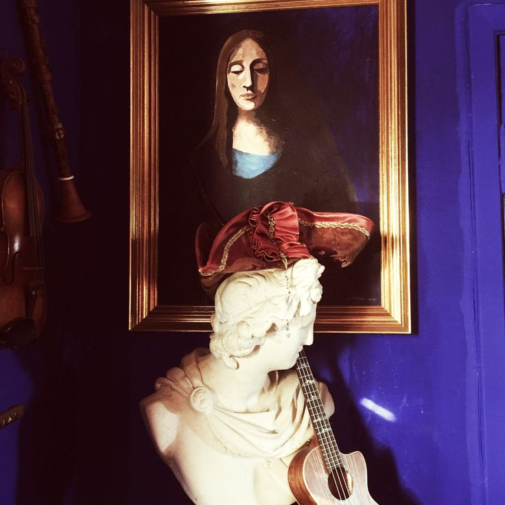 My portrait of a woman staring down on Apollo, the god of music #library