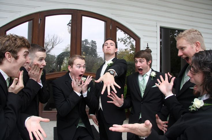 Groomsmen checking out the groom's ring - 42 Impossibly Fun Wedding Photo