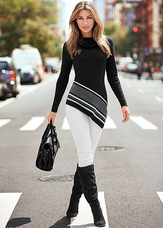 Start off the season in a traffic stopping outfit. Venus asymmetrical hem sweater with Venus color skinny jeans and Venus block heel boot.