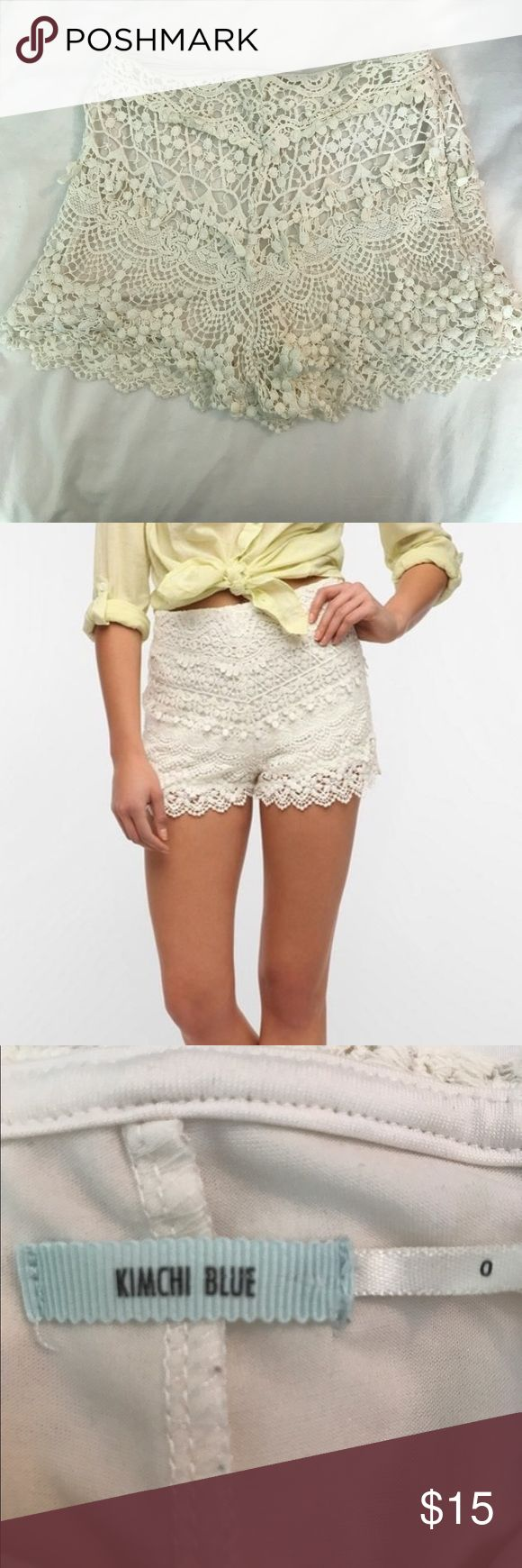 URBAN OUTFITTERS LACE SHORTS cream lace shorts that have been only worn once or twice. Size 0. It is a little high waisted but not as high waisted as the picture seems but it is stretchy and has a shorts lining underneath. Also had zipper and hook on the side. Urban Outfitters Shorts