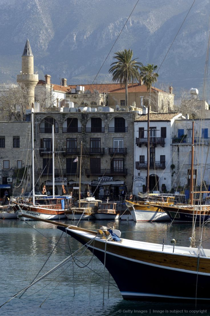 Cyprus, Kyrenia, harbour, boat in foreground, beautiful buildings. Kyrenia is stunning.