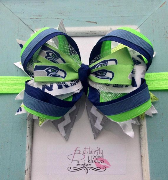 NFL Seahawks stacked bow football by ButterflyKissedB on Etsy