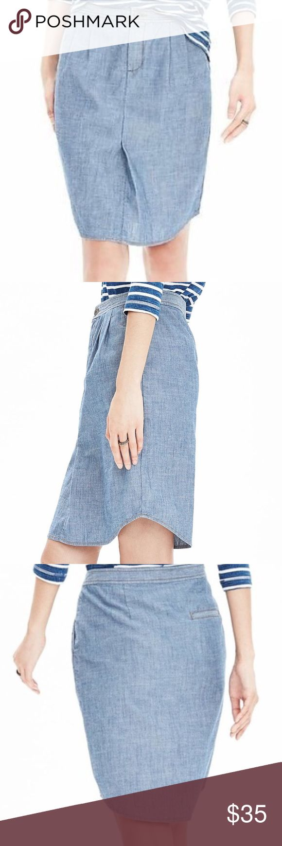 """Banana Republic Chambray Shirt Tail Skirt Updated staple! The denim skirt gets a facelift. Featuring 11/4""""contour waistband, zipper fly closure, slash pockets on front, pleats at front, darted back with functional welt pocket. Shirttail hem, unlined. 98% Cotton 2% Spandex Machine washable 21"""" overall length Banana Republic Skirts"""
