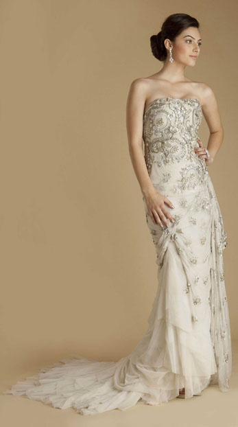 Embroidered tulle strapless gown with custom designed, hand appliqued Hemla lace. Hand embroidered work features dabka, zardozi, nakshi, and cut work beads over tulle underlay by Gaurav Gupta $6,680
