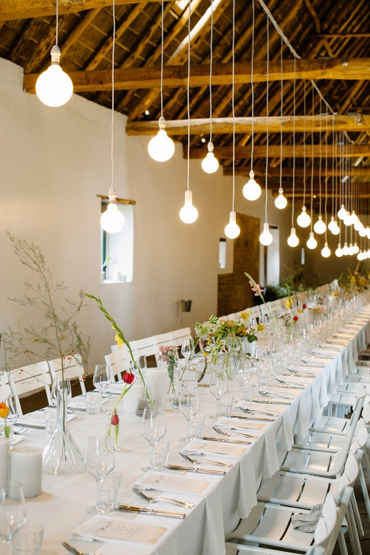 long table setup wedding reception%0A a mega long table setting with stunning lighting