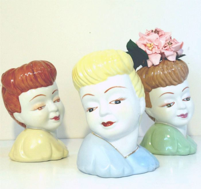 Enjoy our vintage inspired reproductions of the much loved lady vases. Charming and quirky, our ceramic vases feature sweet ladies with 1950's hairdos and pastel outfits. Each container is in the shap