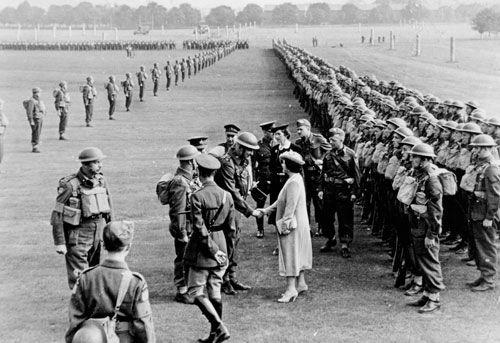 King George VI and Queen Elizabeth review the Regina Rifle Regiment, 1940s.