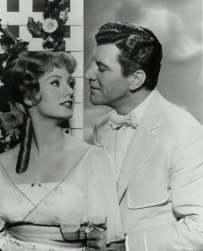 Shirley Jones and Robert Preston in Music Man. I love this musical.  Lots of interesting undercurrents in the plot, plus it's the only musical that has barbershop quartets for many of the songs. Great costumes, too.