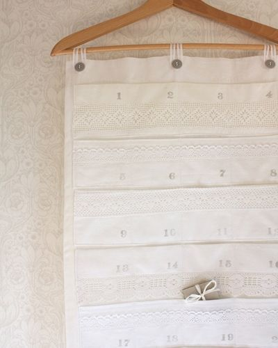 Creative: Eleven Cute Advent Calendars  (Made from vintage linen and lace trims, this advent calendar is simply lovely. Tuuni, via Etsy)