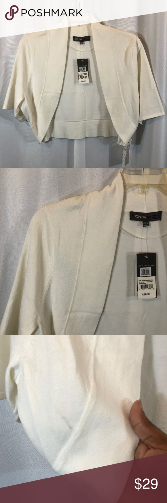 """Donna Ricco Ivory Shrug/Bolero Sweater, Size 2X NOTE: There is a small mark grayish-black on the sweater as shown in the photos.  Brand: Donna Ricco Size: 2X Material: 70% Rayon, 30% Nylon Condition: Brand new with tags   Approx. Measurements   Bust: 46""""  Length: 18"""" Donna Ricco Sweaters Shrugs & Ponchos"""