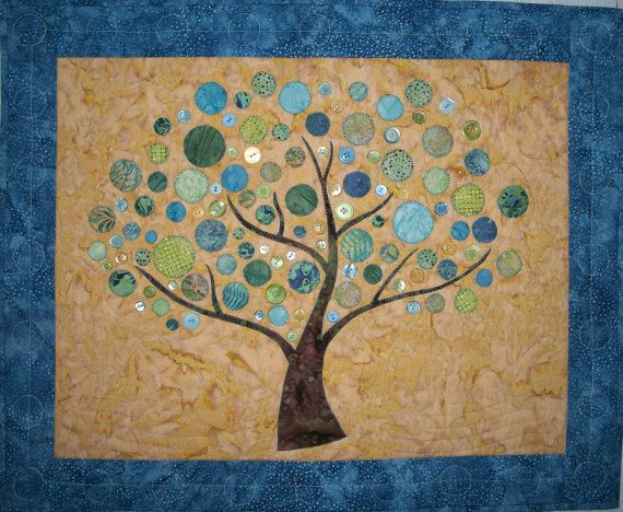 This is a wall hanging quilt kit from my friend's, Karen Pratt, Etsy site.  This design is called Branching Out.  It includes the pattern and quilt top batik fabric. You add buttons and machine applique skill.