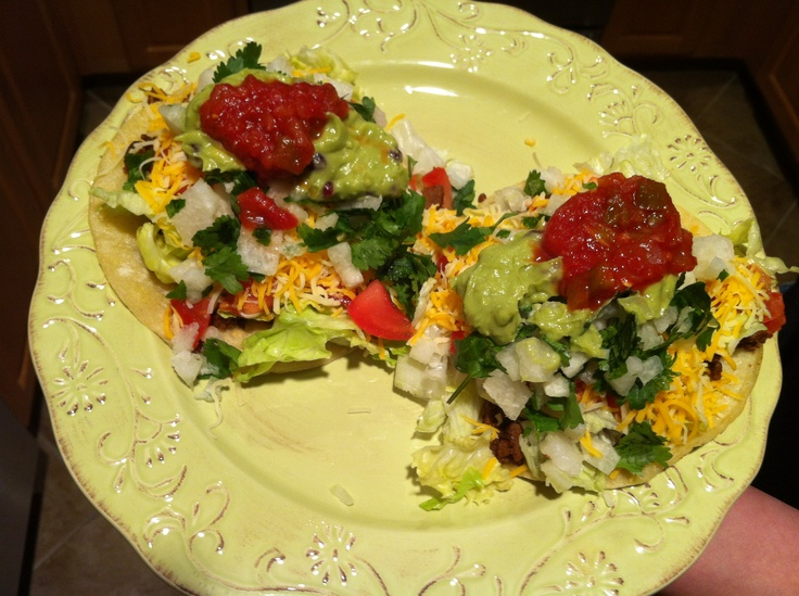 M&M's saturday night dinner date!  We made tostadas with seasoned soy, lettuce, cheese, tomatoes, jicama, cilantro, homemade pomegranate & mango guacamole, a dash of salsa and lots of lime.  Yummy!!!