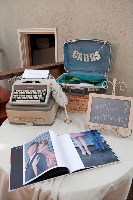 1960s themed wedding DIY guestbook table (typewriter for well wishes, photobook for guests to sign, DIY card box from old suitcase)