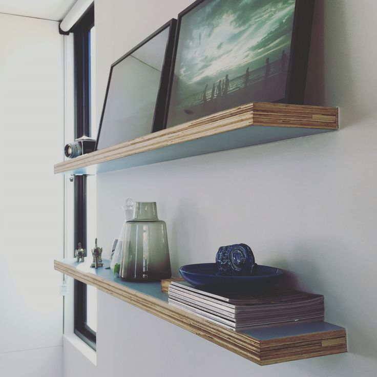 Ply shelving with 3 pack paint finish to face.