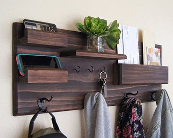 Coat hooks, mail storage, and a place for your necessities means an organized entryway! Keep your busy household stylishly organized with this
