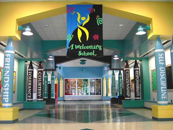 A welcoming school lobby! Love the words (could be used in our hallways around the lights)  and the colors