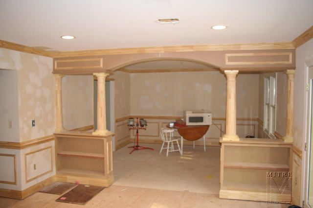 Half wall bookcase with columns built ins half wall - Built in room dividers ...