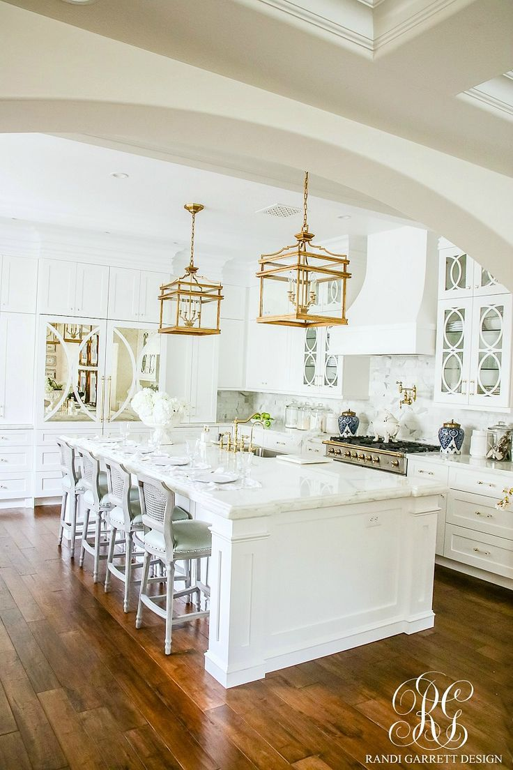 White kitchen with marble counterops, craftsman cabinets, and polished brass lantern lights. Soothing Summer Home Tour 2017 - Neutral Transitional Home Decor