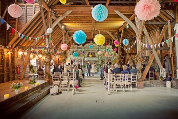 Stunning decorated barn - pompoms & bunting