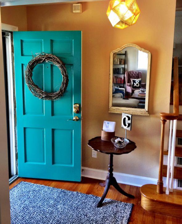 turquoise front door. benjamin moore: aruba blue. + tom dixon light! love the looking glass blog.