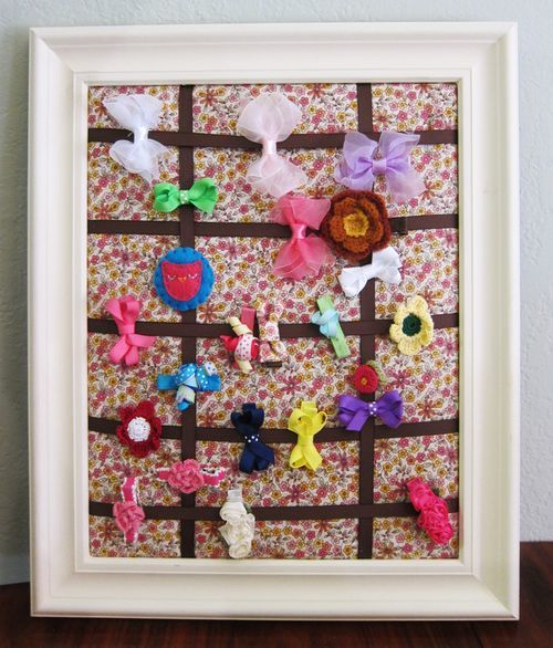 Homemade hair-clip board doubles as decor for your girl's room.  If you have little girls you know how hard it is to find a clippie when you need one - much less two.  This might solve your problem.