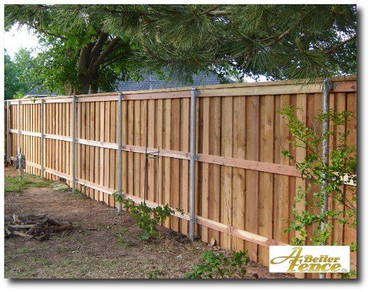 Fencing ideas decorative privacy fence with full trim for Wood privacy fence ideas