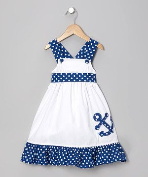 Crafted with soft cotton and simple buttons for easy changing and dressing, this peppy maritime piece is sure to anchor any little lady's wardrobe.