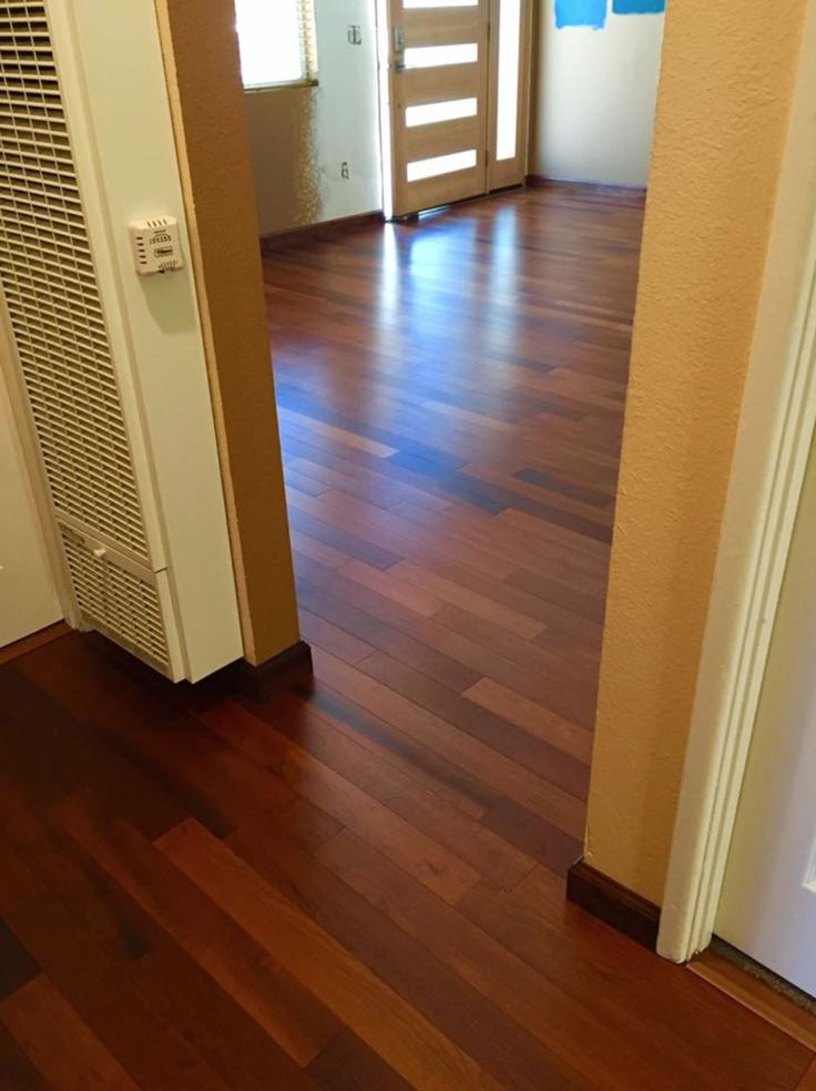 This hall features Lauzon's Borneo. This magnific torrefied Hard Maple flooring from our Reserva series enhance this decor with its marvelous brown shades. This hardwood flooring is available in option with Pure Genius, Lauzon's new air-purifying smart floor. Project by Geneva Flooring.