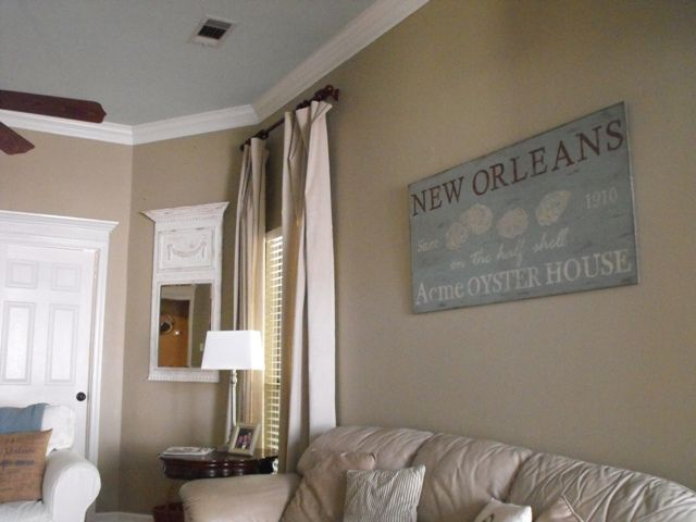 Nice use of subtle hues.  Sherwin Williams Relaxed Khaki on walls and Rainwashed on ceiling.  Love painted ceilings.  From this blog: http://www.susieharrisblog.com/2011/10/our-family-room.html