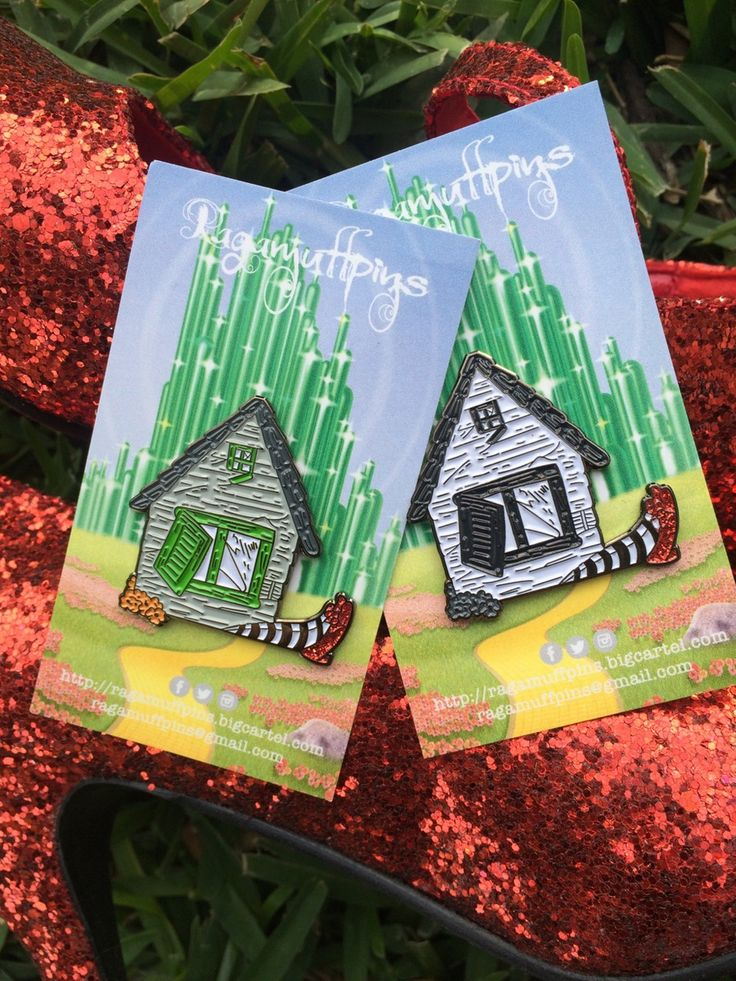 "Get both variants of our Oz pin and save $6. Both pins are 1.5"" hard enamel with glitter ruby red slippers!"