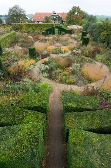 Imagine stepping through that hedged entrance to discover this garden! Another beauty from Piet Oudolf and a wonderful reminder of how powerful and important the structure of a garden is.