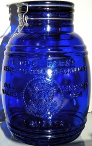 Huge cobalt blue glass cookie jar with American eagle Uncle Ezras