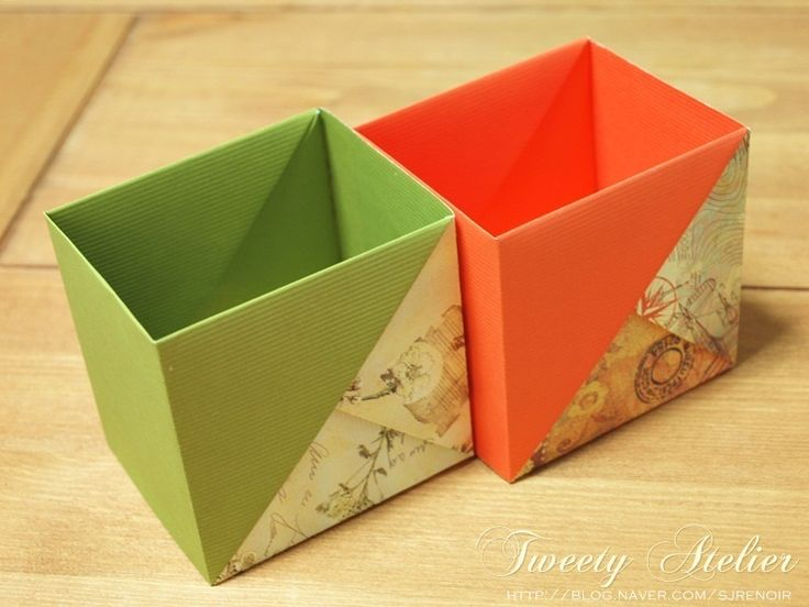 "Origami boxes with photo tutorial. Diagrams here: http://www.duitang.com/people/mblog/64700164/detail/ Letter sized paper (8.5"" x 11"") made a cube-ish (7cm x 7.5cm) shaped box. A4 sized paper made a rectangular box. Letter paper folded lengthwise made a 6.5"" X 2.25"" box."