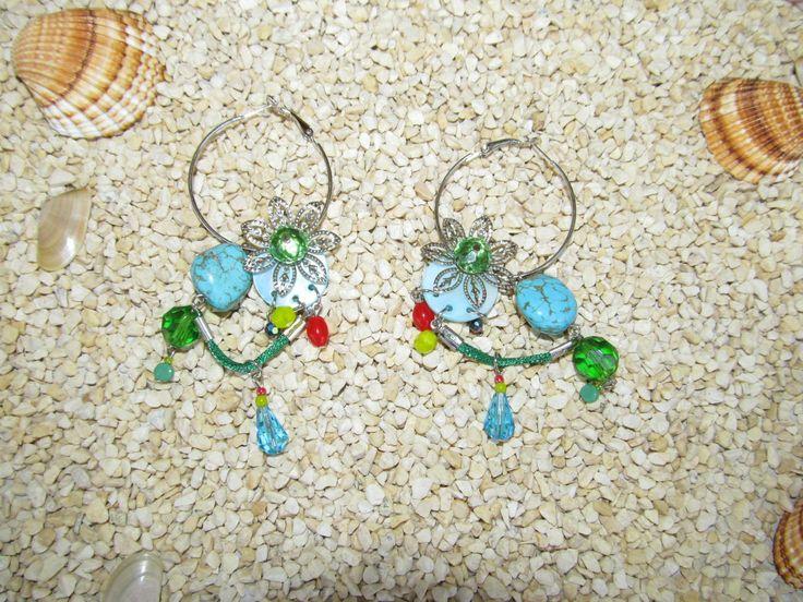 Handmade earrings (1 pair)  Made with antiallergic hoops, metal flowers, metal look green cord, glass beads and gemstones.