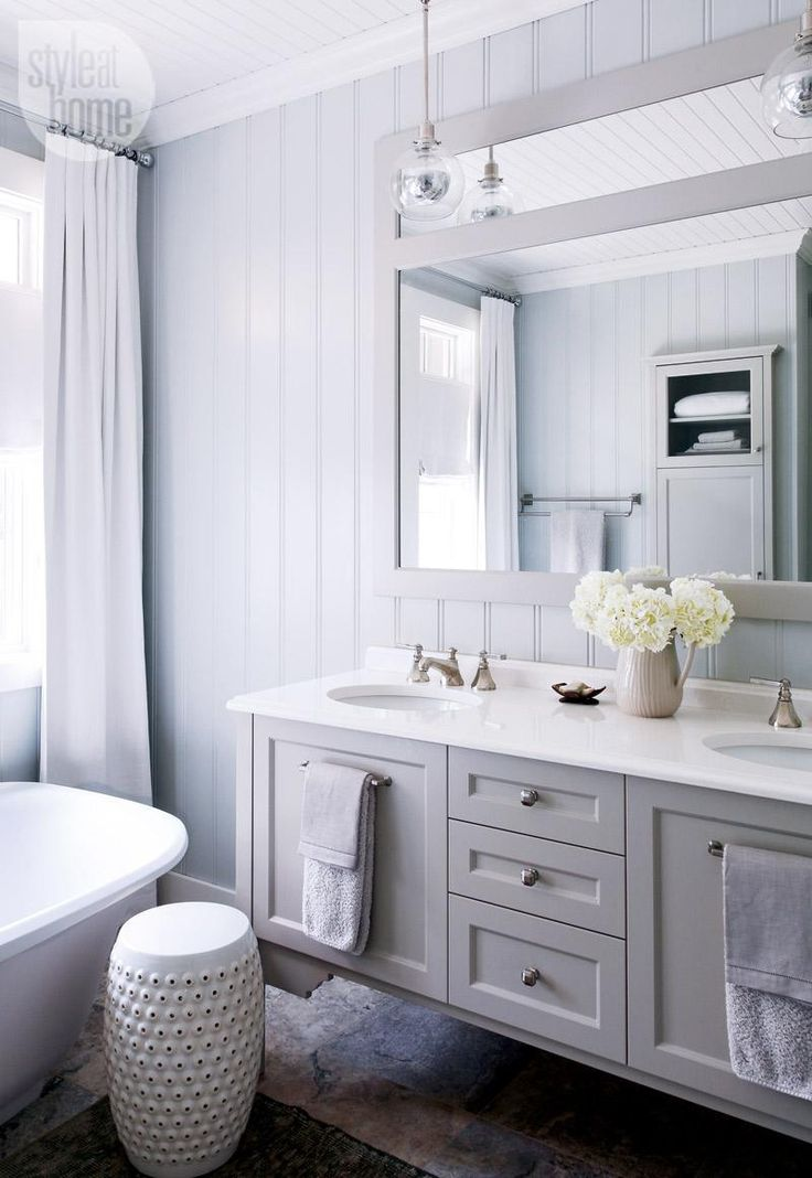love the floating vanity with towels on front of cabinet doors and hanging pendant lights