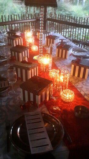 Red, black, white & crystal dinner table. 70th birthday dinner