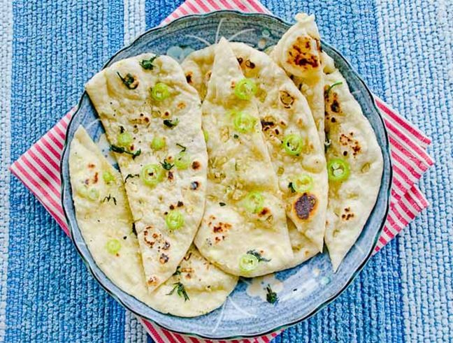 Easy recipe of soft and fluffy garlic naan, with step by step instruction to show how to make the best naan using stovetop.