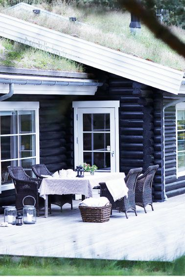 White washed interior cabin with black exterior
