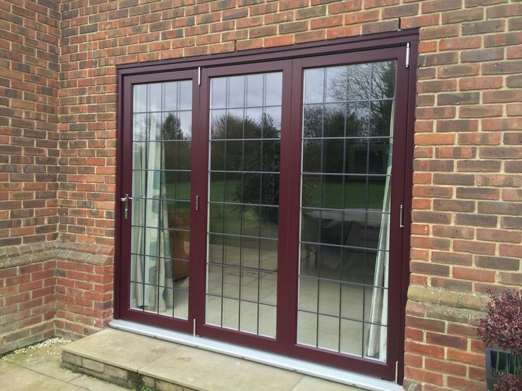Timber Folding Doors with rectangular leaded glass. Old Burgundy painted finish