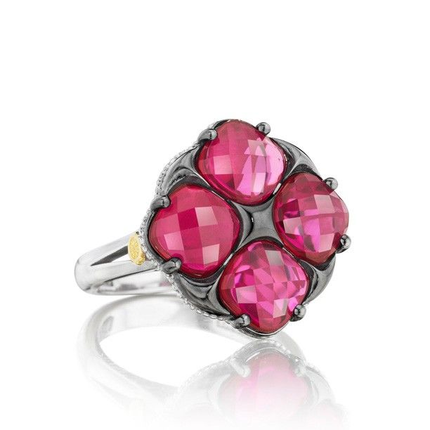 Transluscent, plush red gemstones dazzle and delight in this black silver setting. Cushion cute and multi-faceted these sparkling jewels are sure to brighten any outfit.