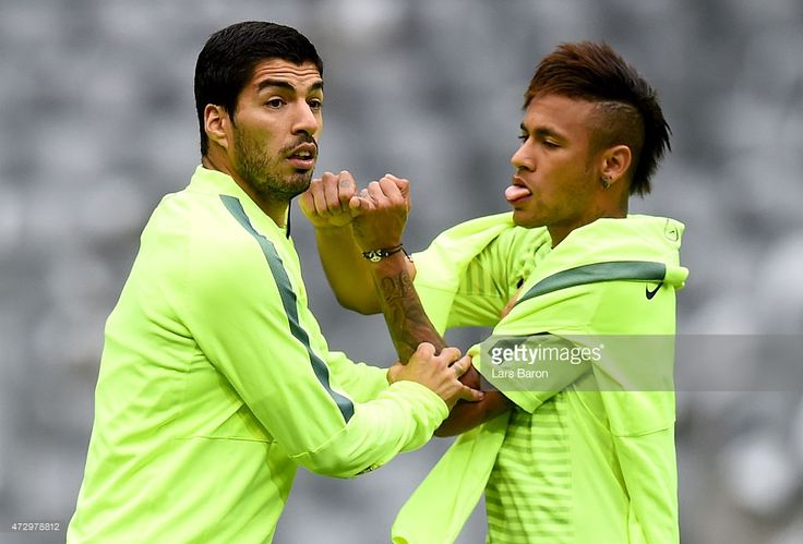 Luis Suarez jokes with Neymar during a FC Barcelona training session on the eve of the UEFA Champions League semi final second leg match against FC Barcelona at Allianz Arena on May 11, 2015 in Munich, Germany.
