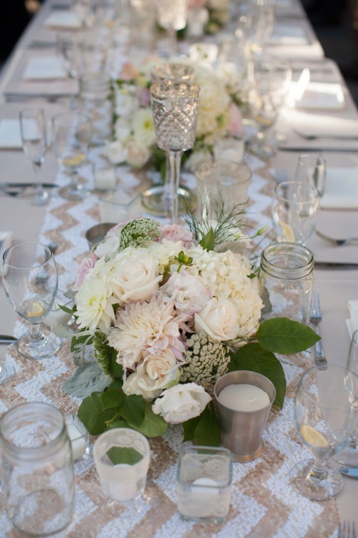 Blush centerpieces with sequined chevron runner // photo by Frenzel Studios, http://theeverylastdetail.com/2013/10/16/timeless-champagne-blush-wedding/