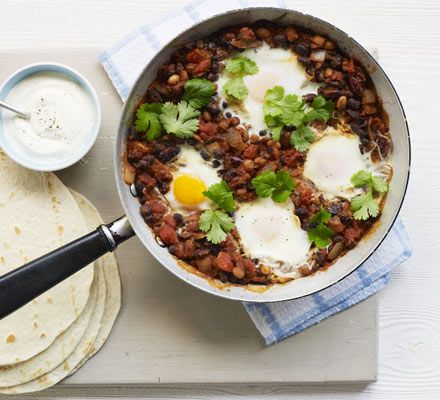 Black beans make a great foundation for this storecupboard, Mexican one-pot with smoky hot sauce, coriander and tortillas